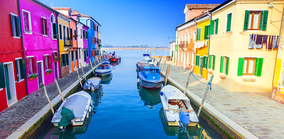 Colorful homes along a canal in Burano, Italy.