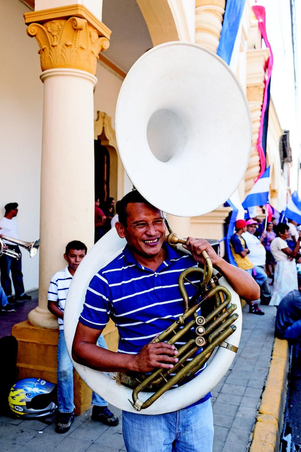 A tuba player at Granada's Parque Central