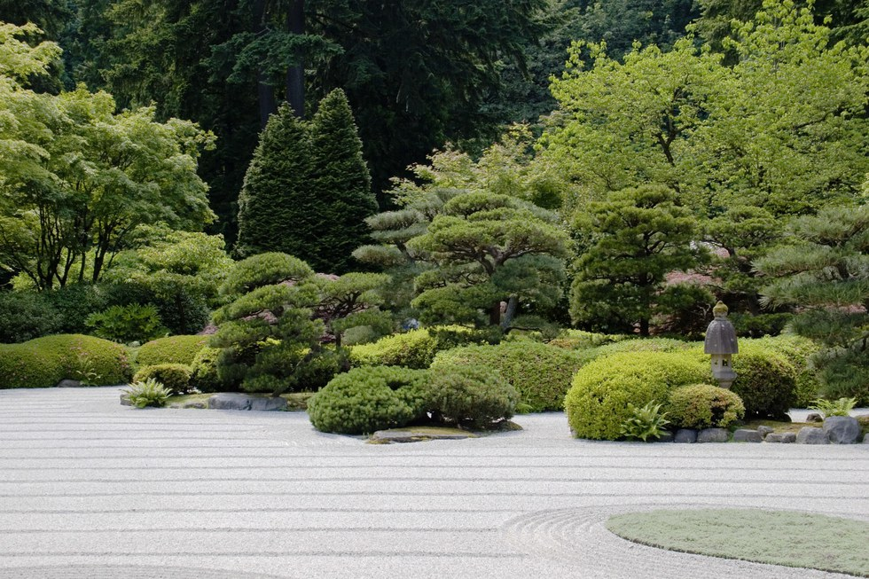 Raked sand and manicured plants at the Portland Japanese Garden