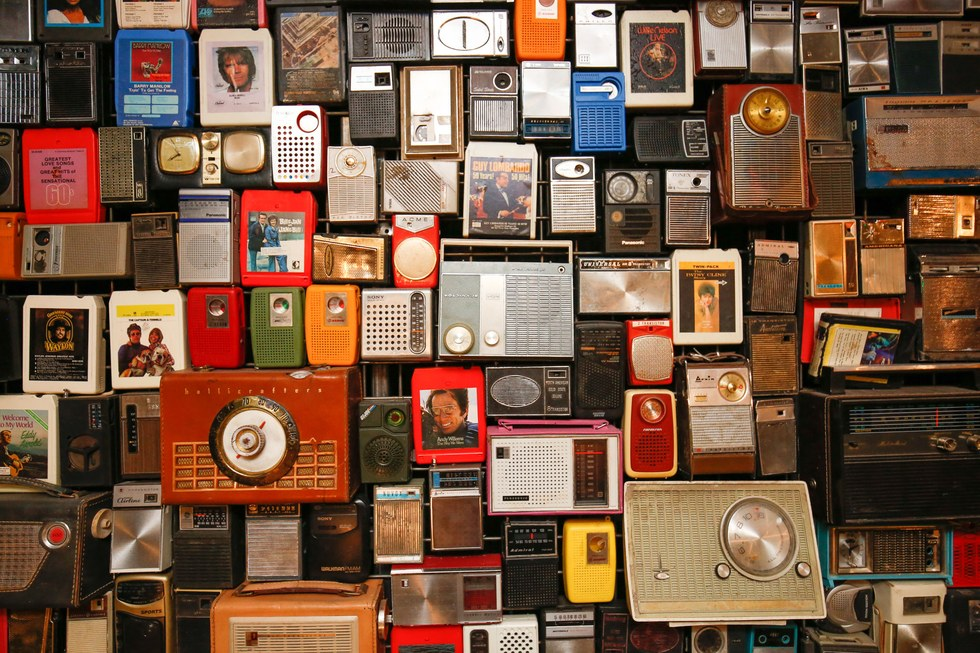 A wall of vintage radios at Ophelia's Electric Soapbox