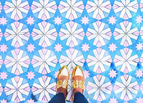 Gold shoes on a colorful pattern on the floor