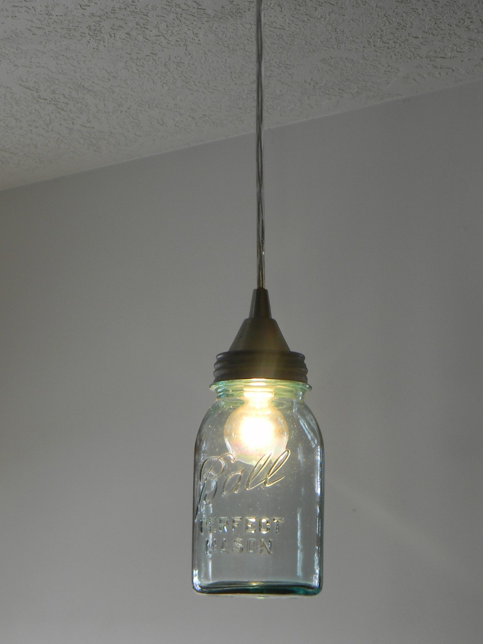 Mason jar diy lighting ideas the snug for Hanging lights made from mason jars