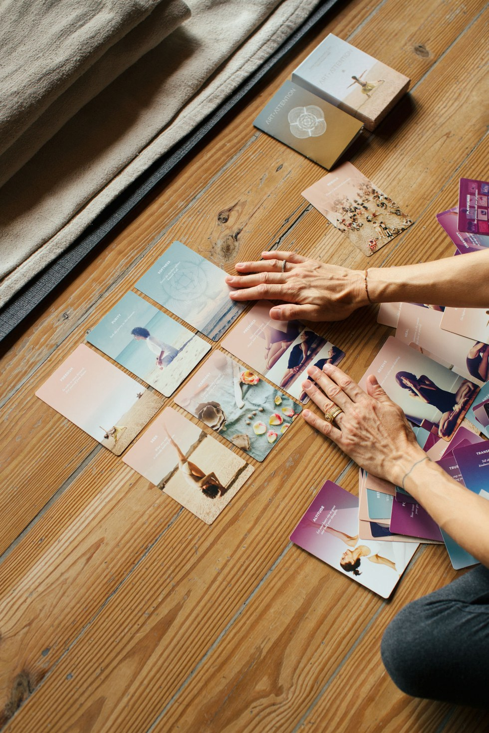 Brower's Art of Attention yoga cards spread out, offering positive affirmations and yoga poses