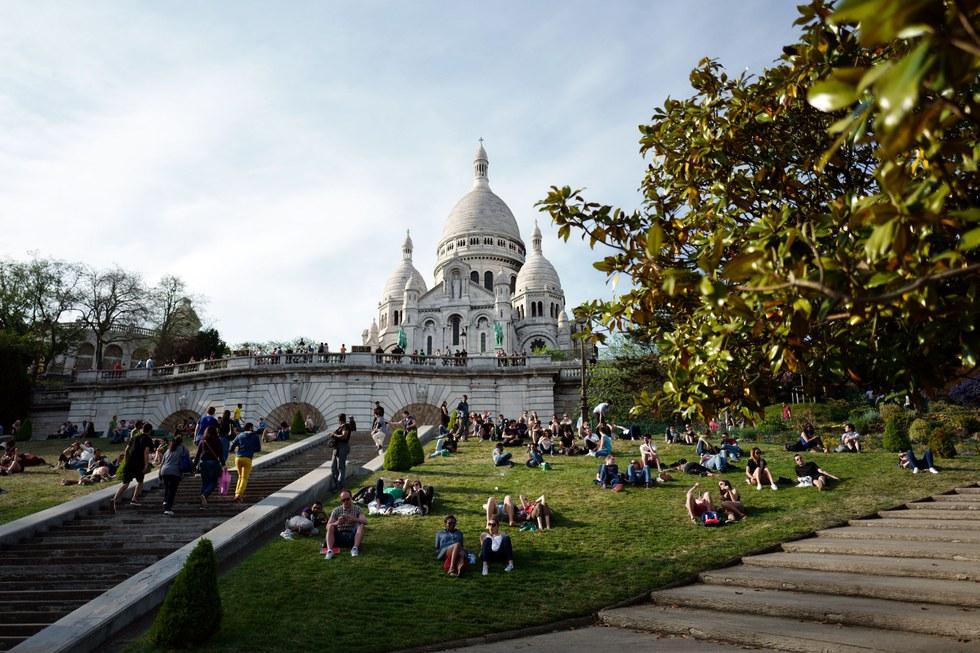 Parisians enjoying the grounds of La Basilique du Sacr\u00e9-Coeur