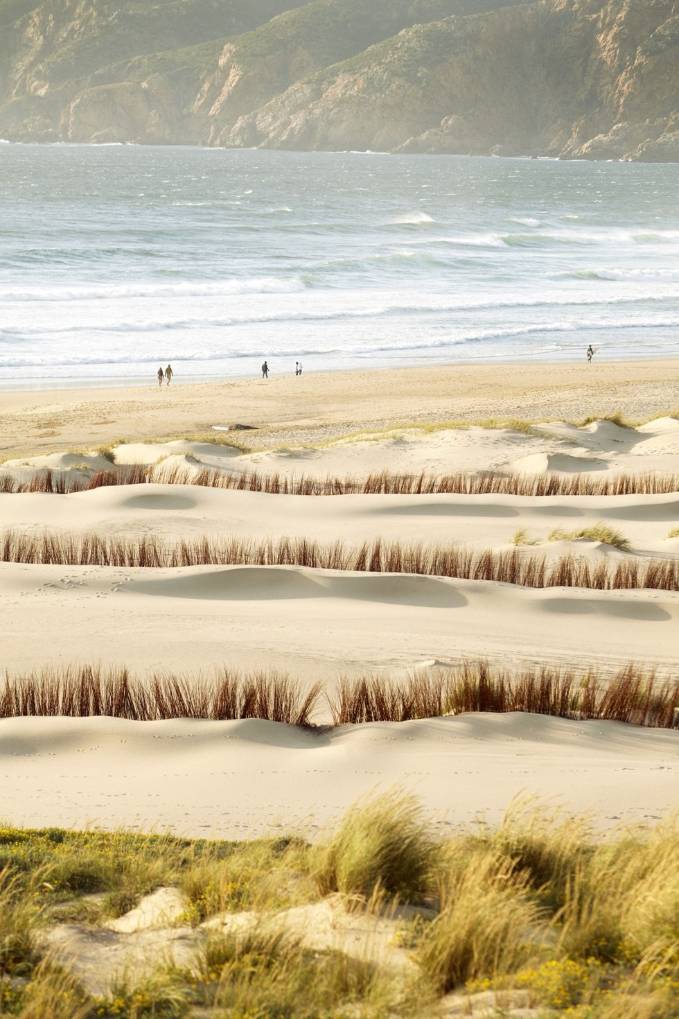 Several sand dunes leading to the beach at Praia do Guincho