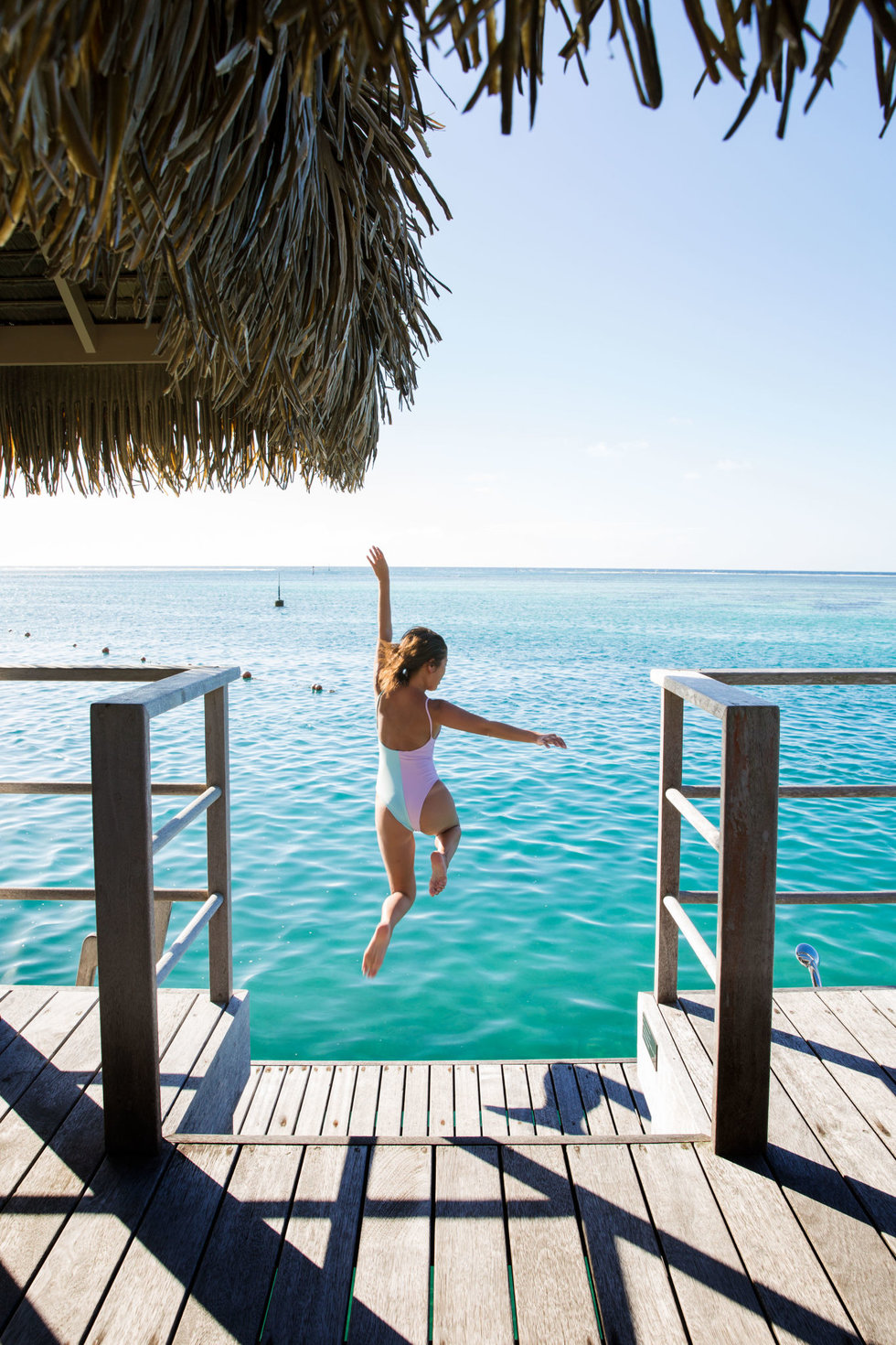 Leaping into the Moorea lagoon