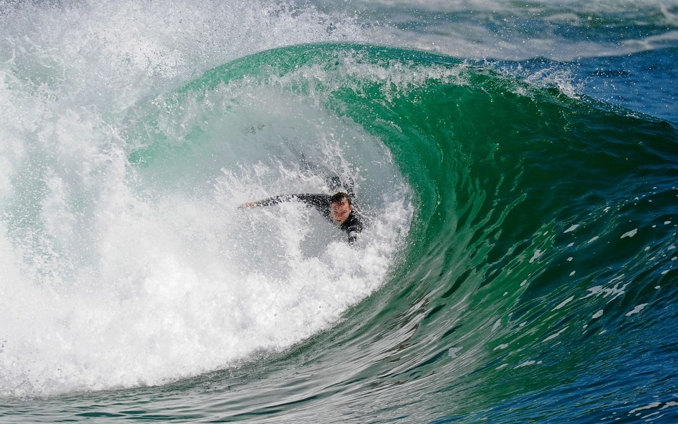 Bodysurfing at the Wedge in Newport Beach, California.