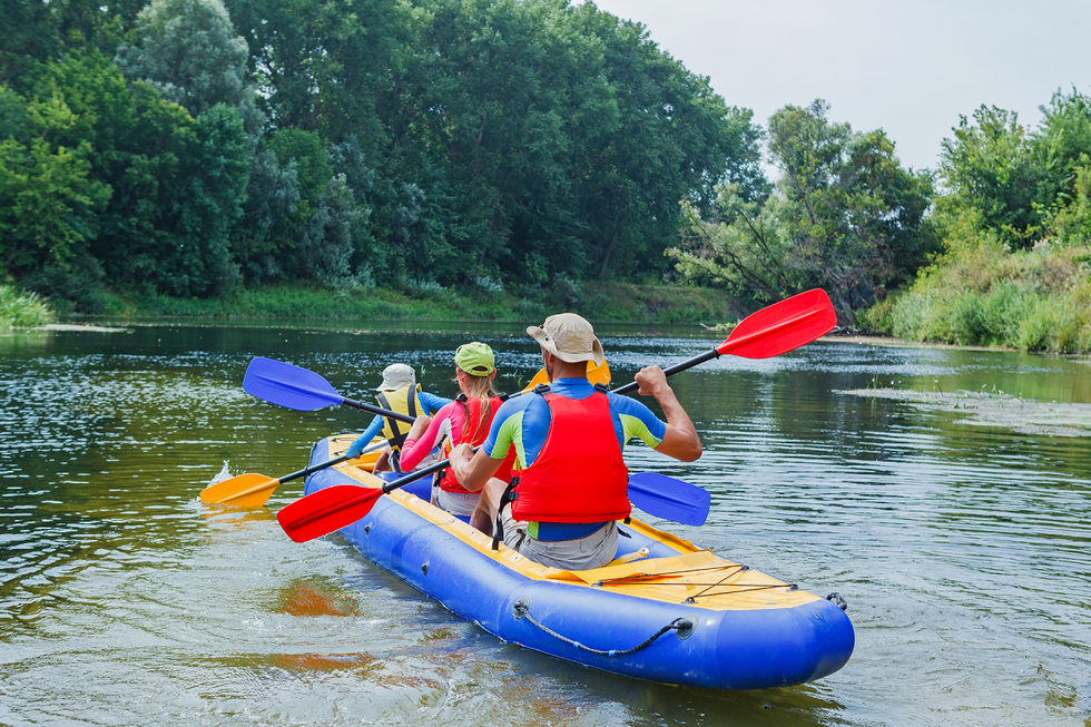 Family kayaking along the river