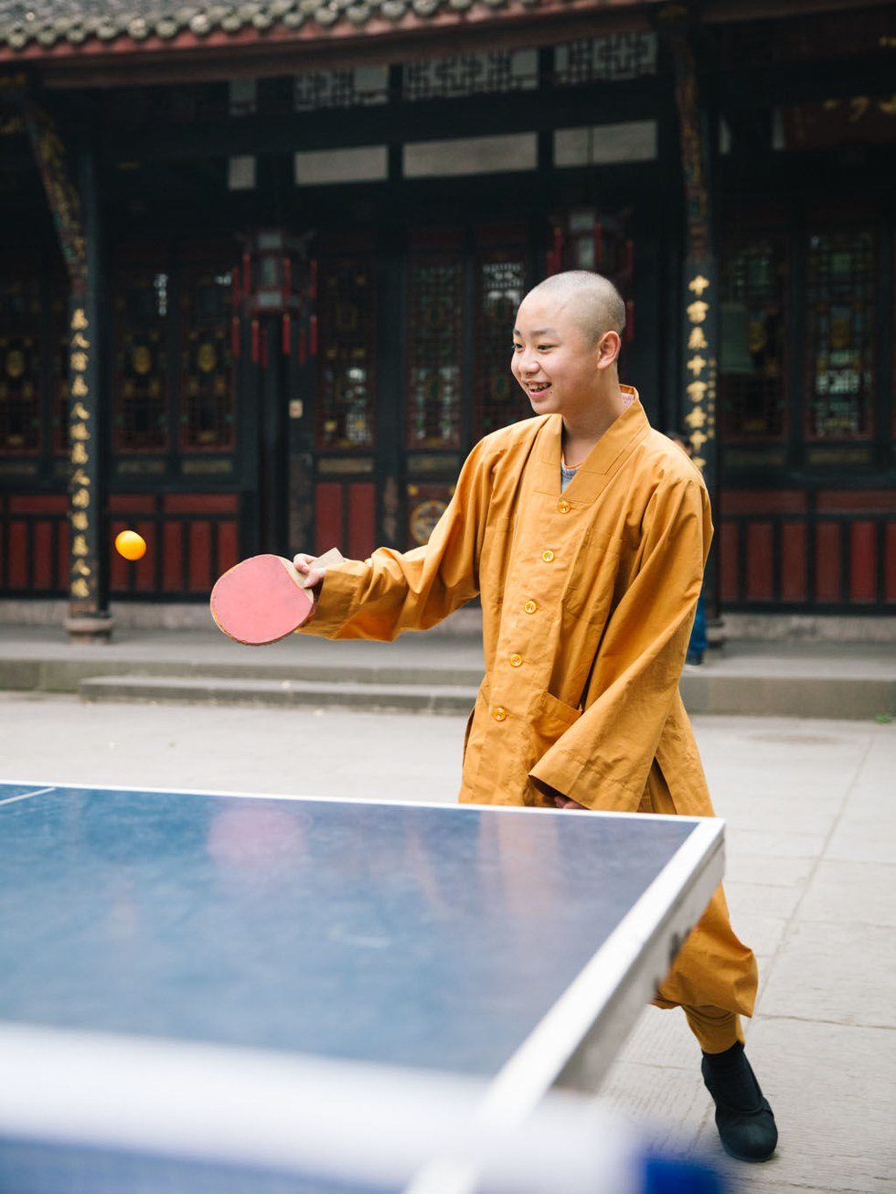 Young monk Long Chen plays ping-pong in Wenshu Temple;