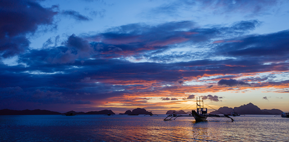 Sunset over the water on the Palawan Islands in the Philippines.