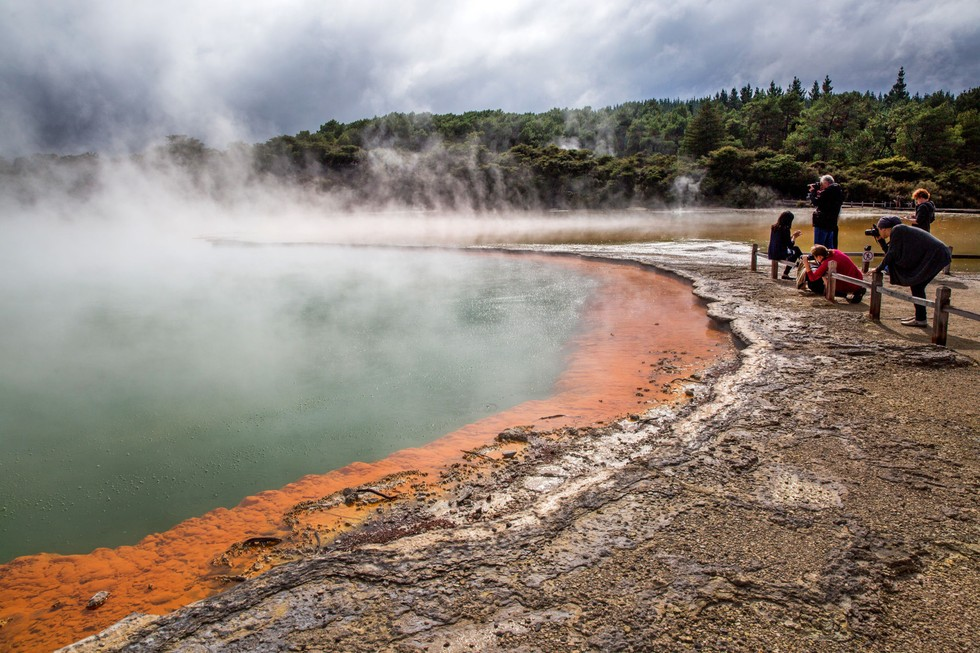 The Champagne Pool is a shade of green and steams with carbon dioxide