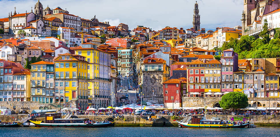View of the colorful building in Porto, Portugal from the sea.