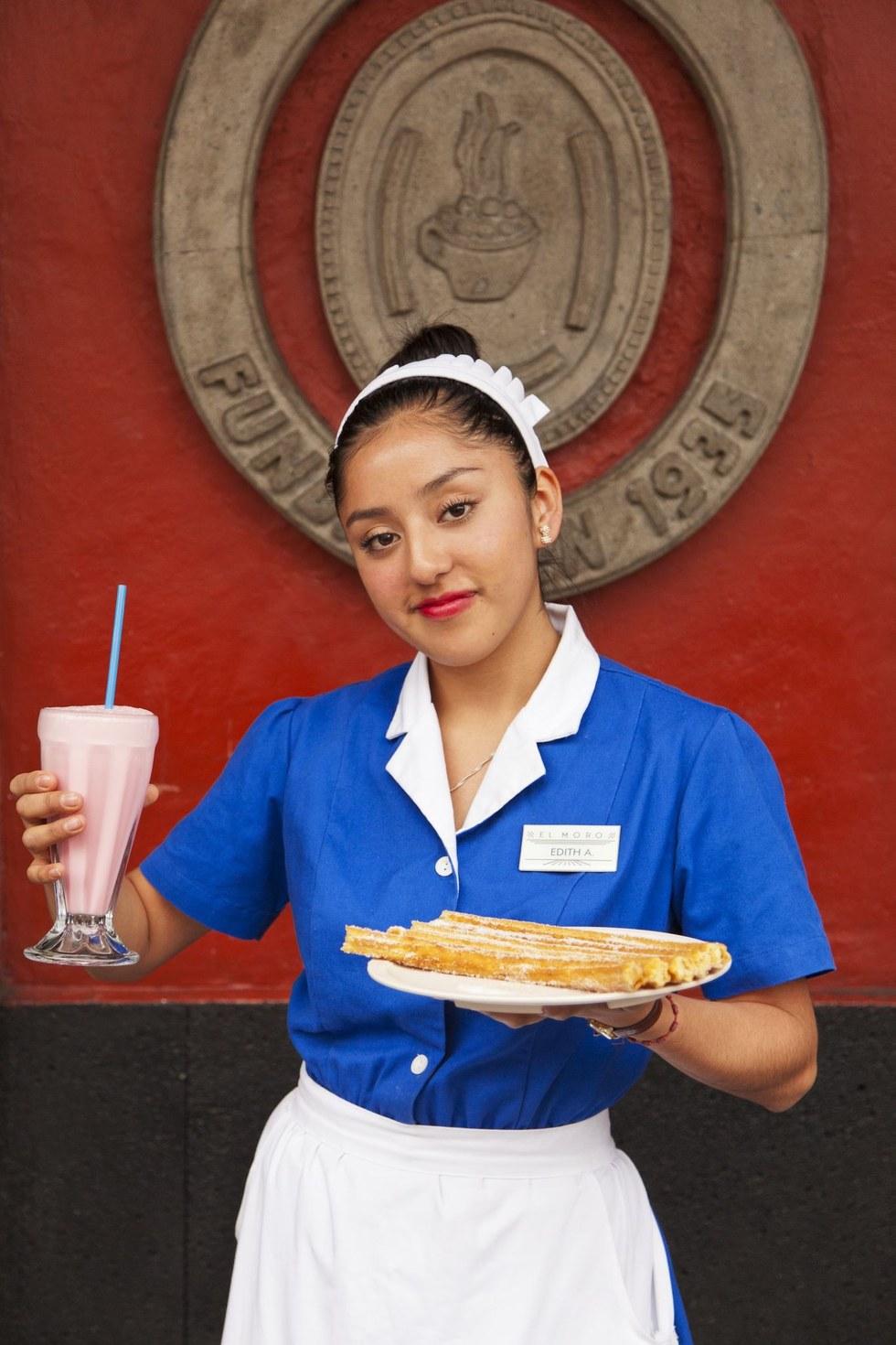 A waitress at Churrería El Moro