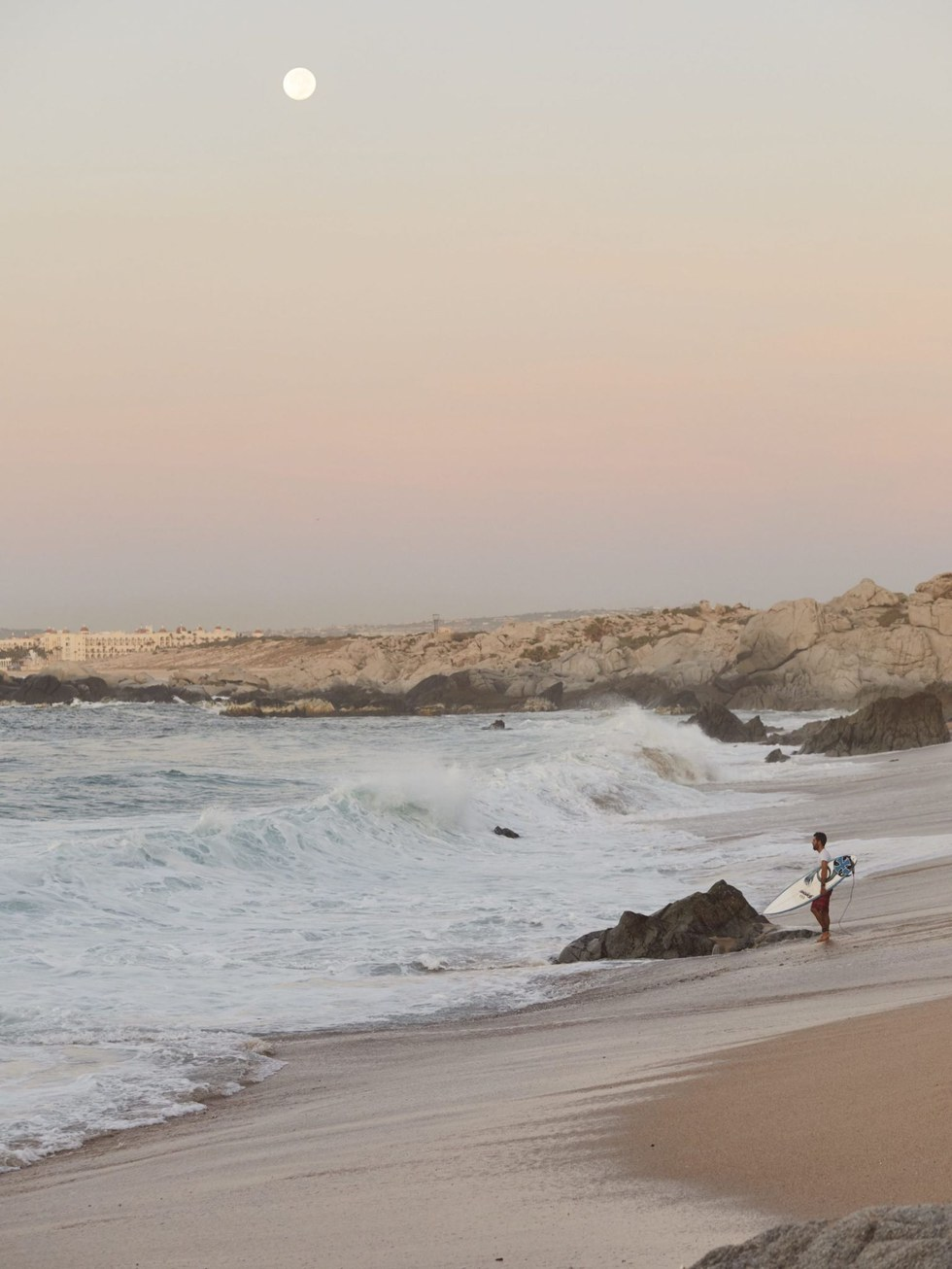 A surfer ready to hit the waves at Costa Azul