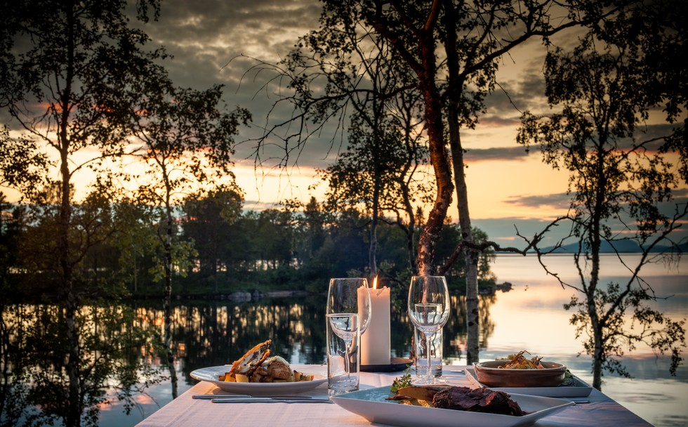 Dinner set up overlooking a lake at sunset