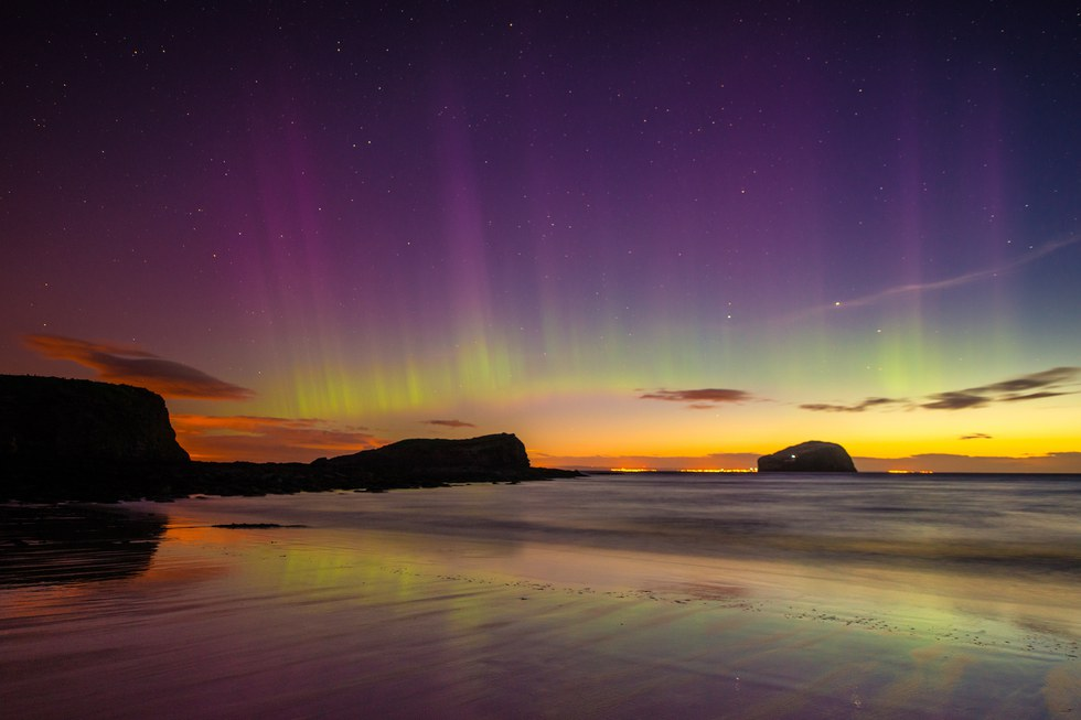 Purple and yellow glow of the Northern Lights in Scotland