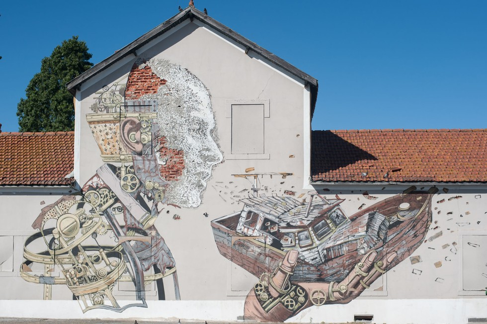 Piece by Vhils and Pixel Pancho