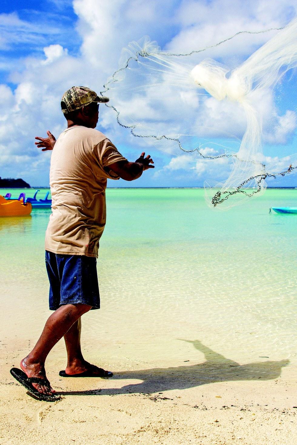 A throw-net fisherman at Tumon Bay