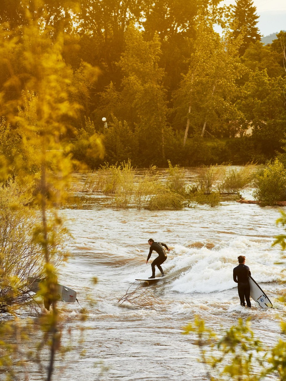 Surfers on the rushing Clark Fork River