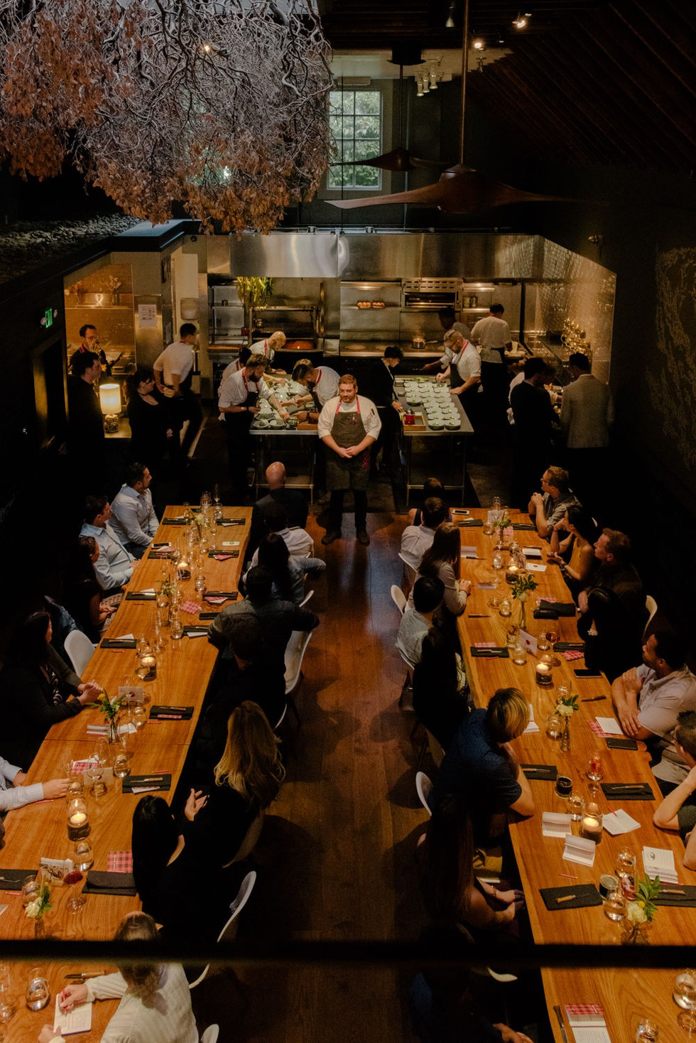The communal dining room and bustling open kitchen at Lazy Bear