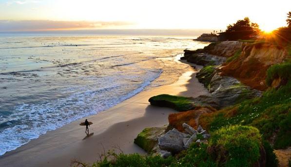 Surfer on the beach in Santa Cruz