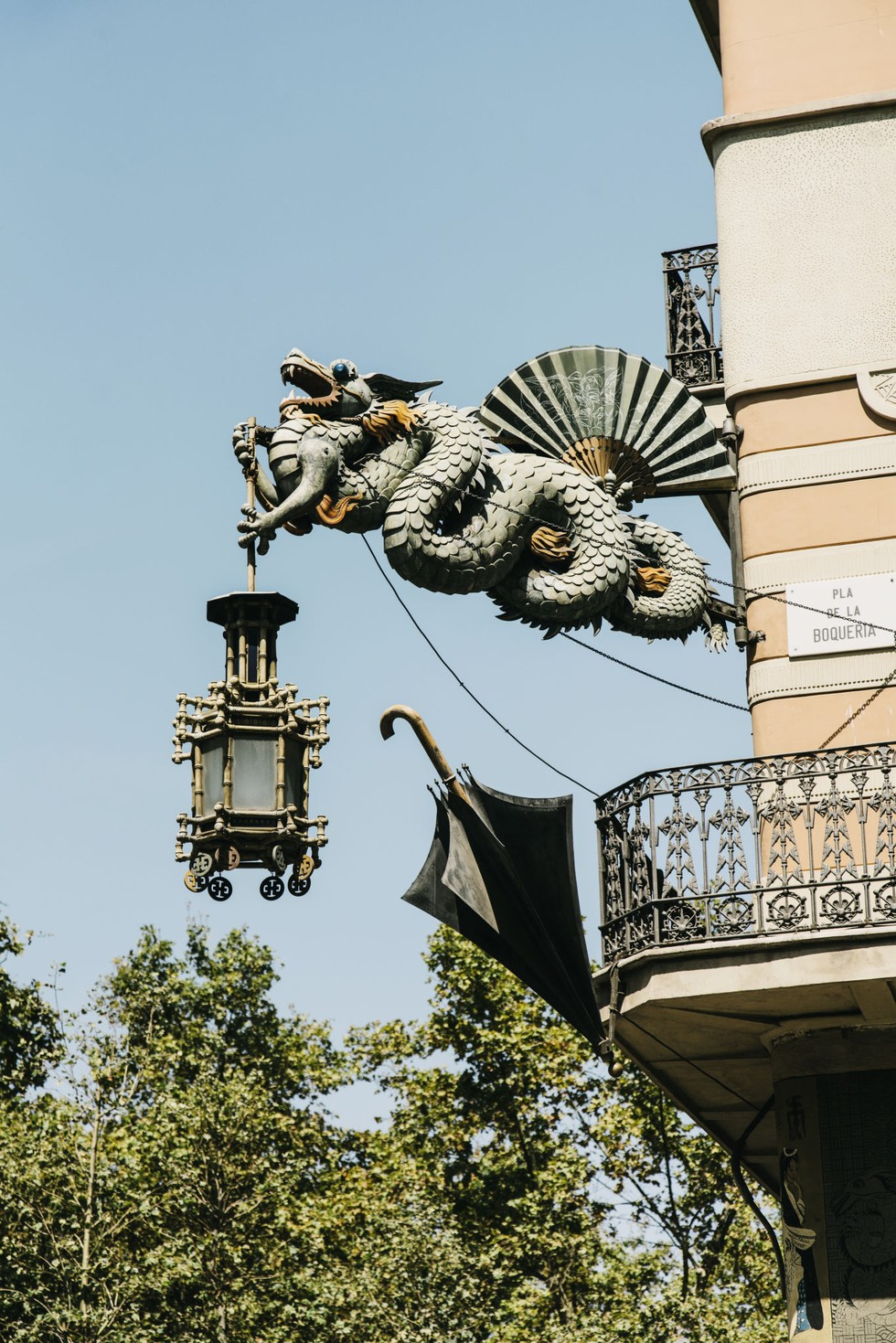 A Chinese dragon sign on a shop on La Rambla