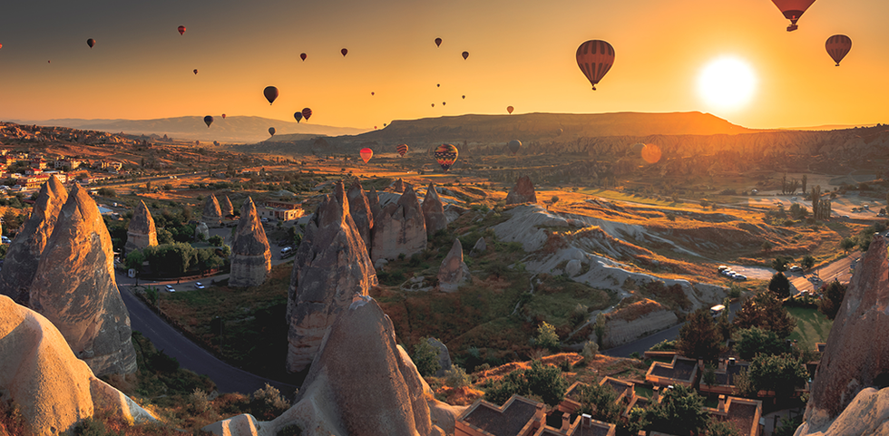 Aerial view of hundreds of hot air balloons in Cappadocia, Turkey.