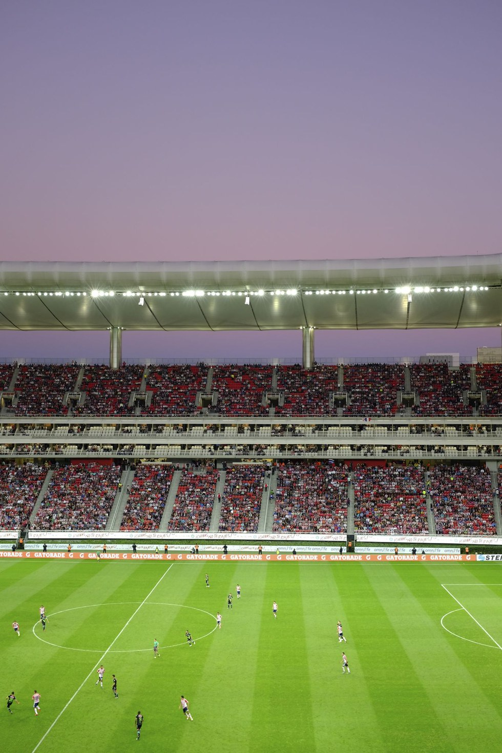 Chivas moves up the field at dusk