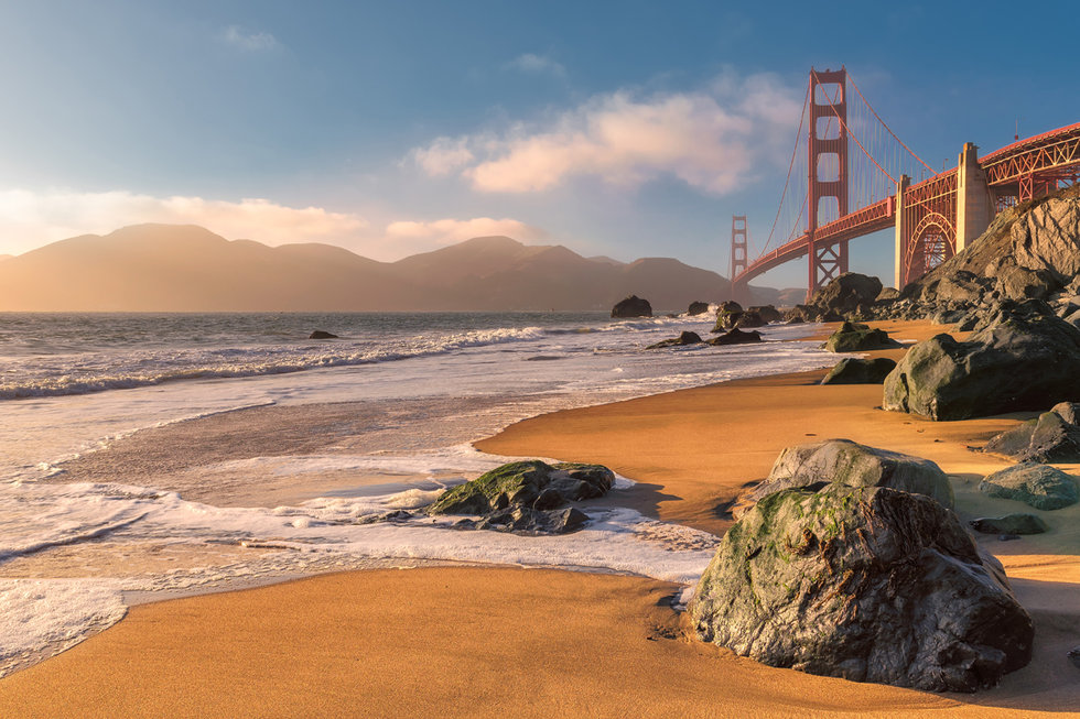 View of the beach with the Golden Gate Bridge in the distance