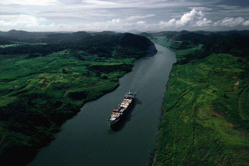 A cargo ship passes through the Panama Canal;