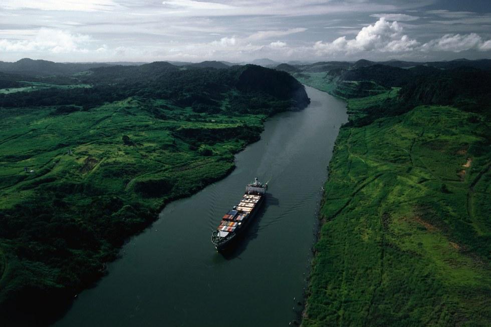 A cargo ship passes through the Panama Canal;