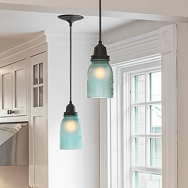 A kitchen remodel gets a touch of soft color with frosted for Hanging lights made from mason jars