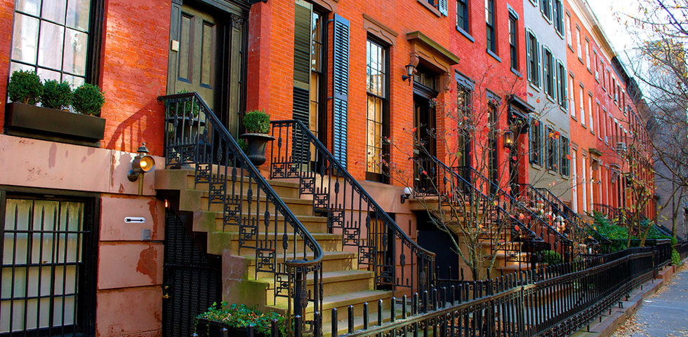 tree-lined streets dotted with brownstones in Manhattan, New York