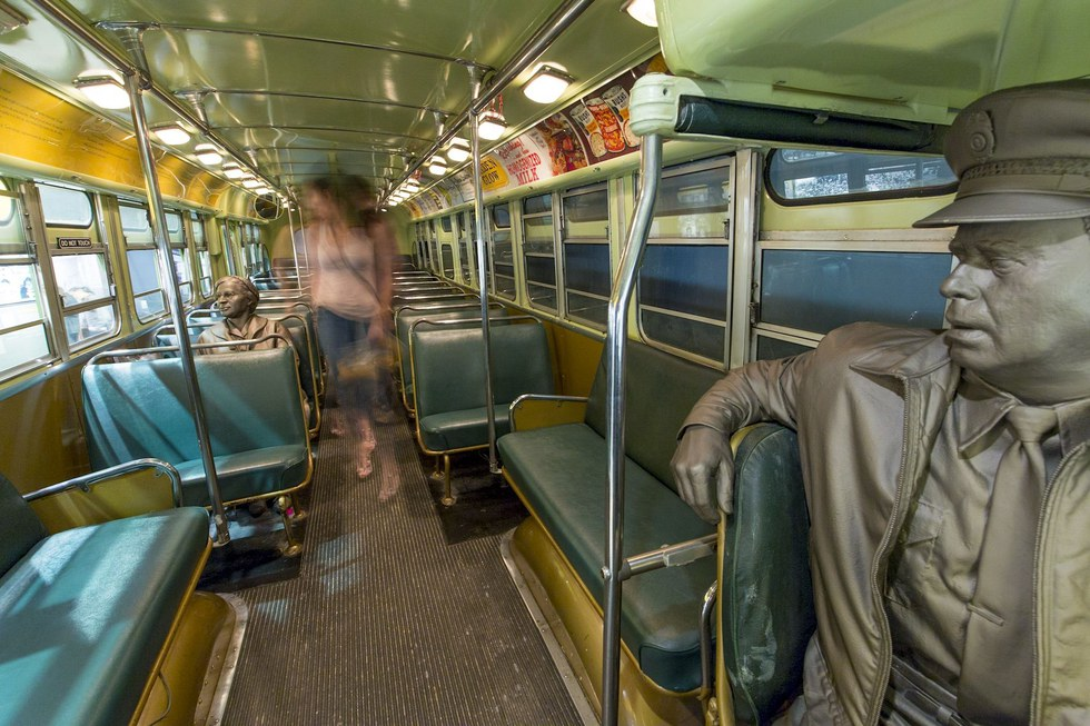 On this 1950s-era bus at the National Civil Rights Museum, white passengers stand for Rosa Parks