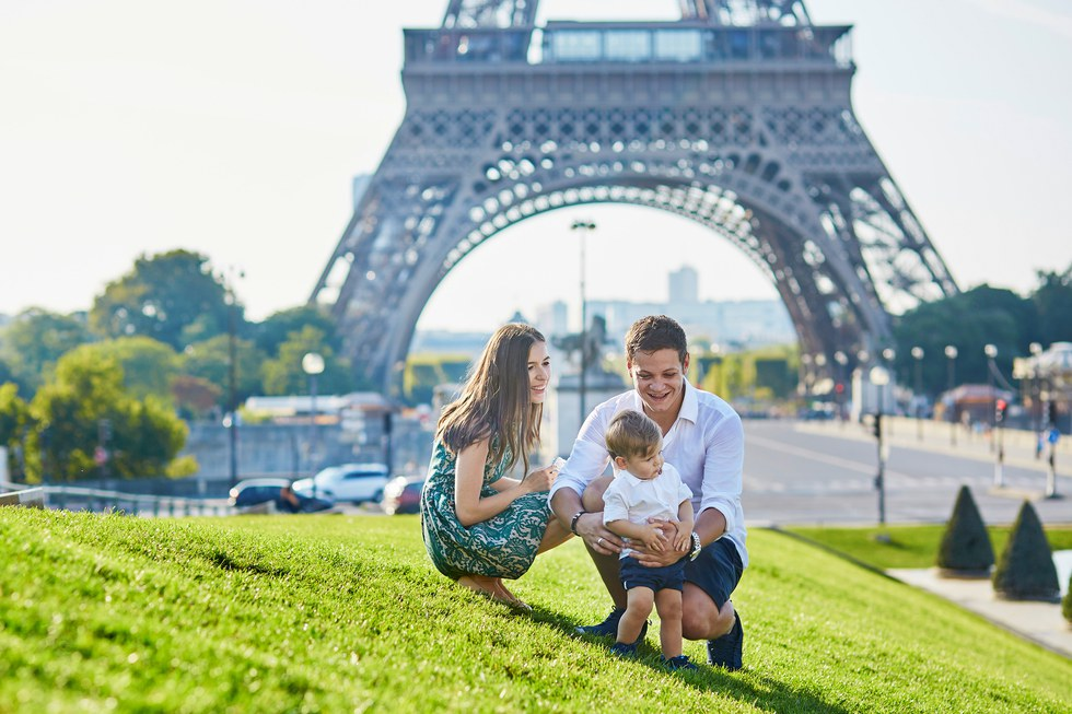 Family in front of the Eiffel Tower