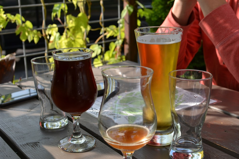 Several different beers on a table at the Beer Festival in Portland, Oregon