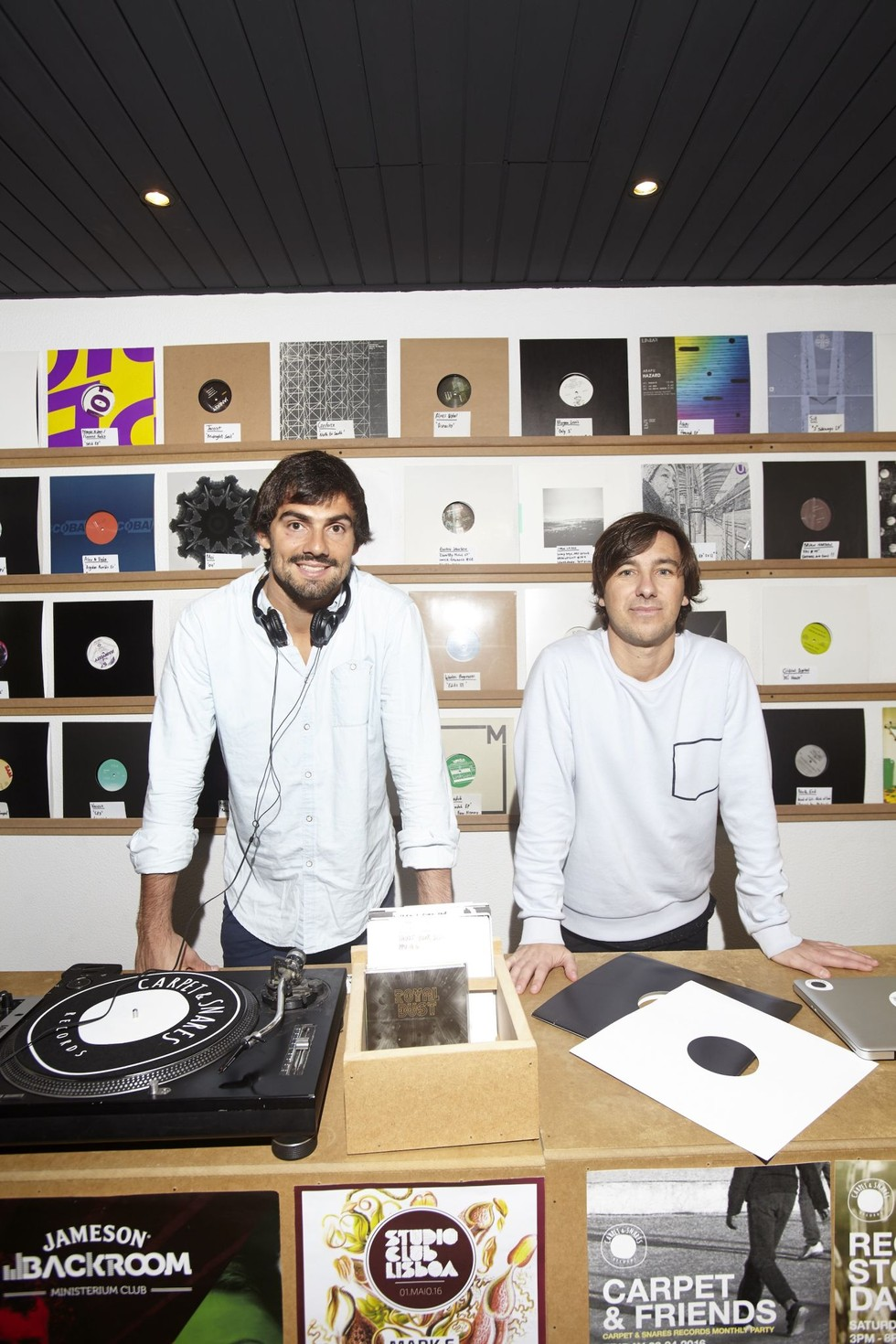 two nightlife entrepreneurs surrounded by albums