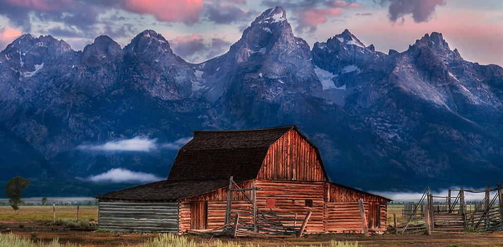 A home overlooking the mountains at sunset in Jackson Hole, Wyoming.