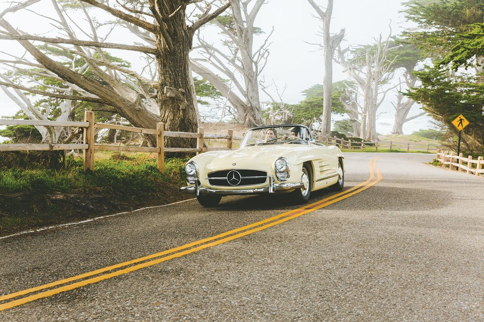 Traveling in style on 17-Mile Drive, in a 1957 Mercedes-Benz 300 SL Roadster