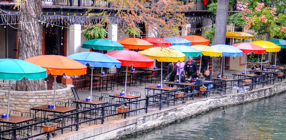 Colorful umbrellas decorate a restaurant along the canal in San Antonio, Texas