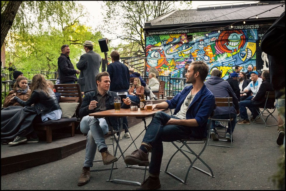Enjoying a pint on the riverside terrace at Bl\u00e5