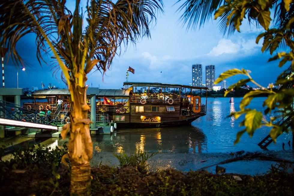 The Lady Hau, a restored rice barge, sails the Saigon River