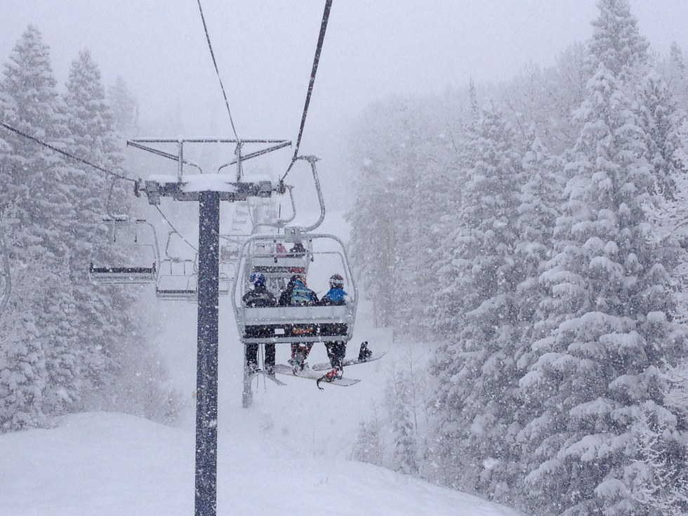 people on a ski lift in Steamboat Springs, Colorado