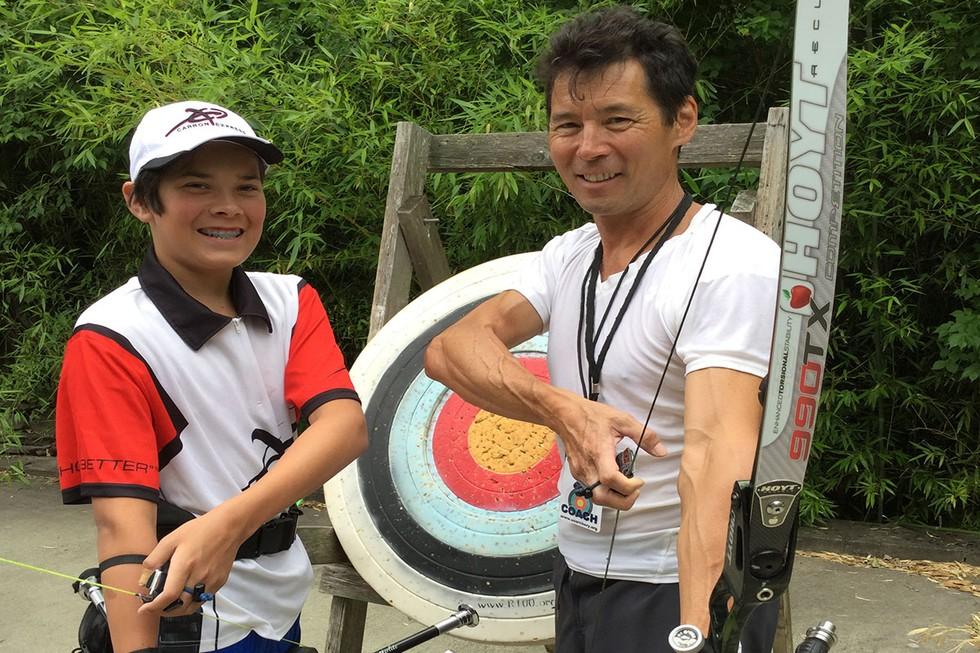 Joe Oka and son Peyton Practice Archery Skills