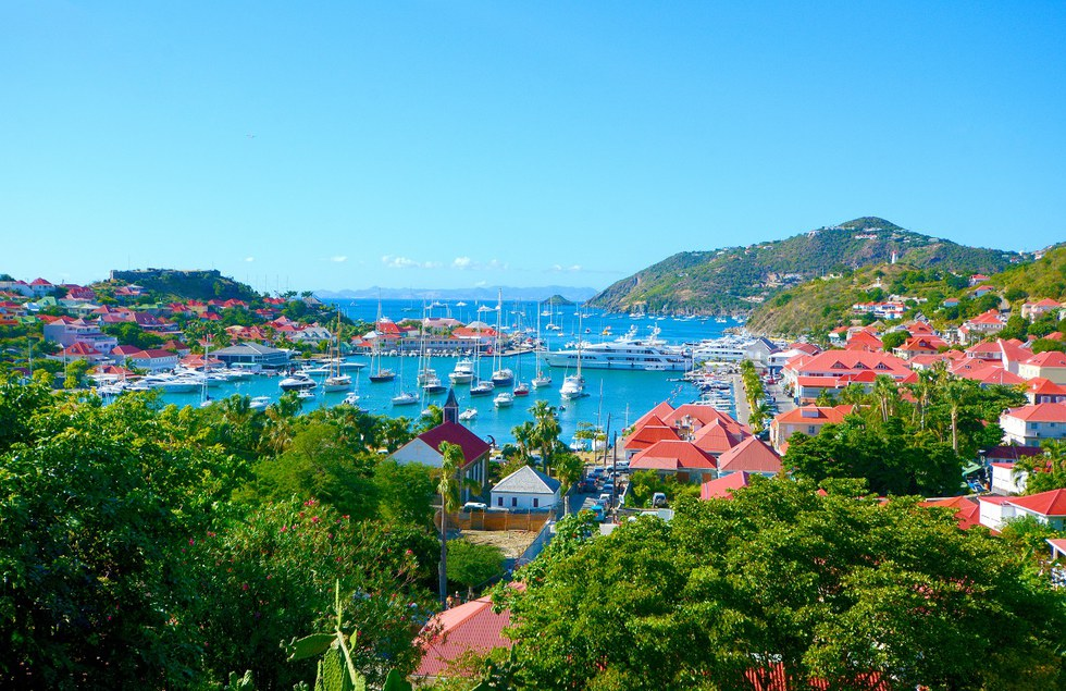 Aerial view of boats docked and houses along the water in St. Barth's