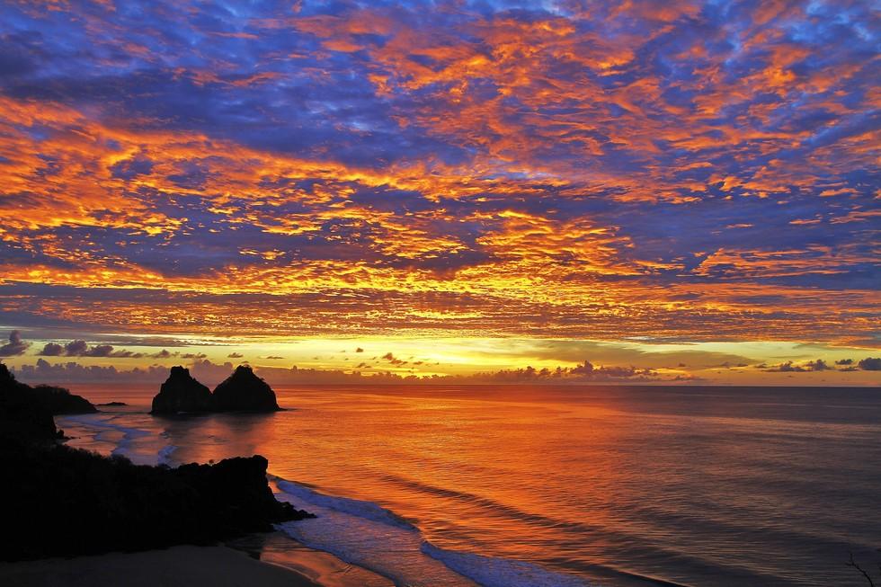Sunset overlooking the ocean on the Fernando de Noronha Island in Brazil
