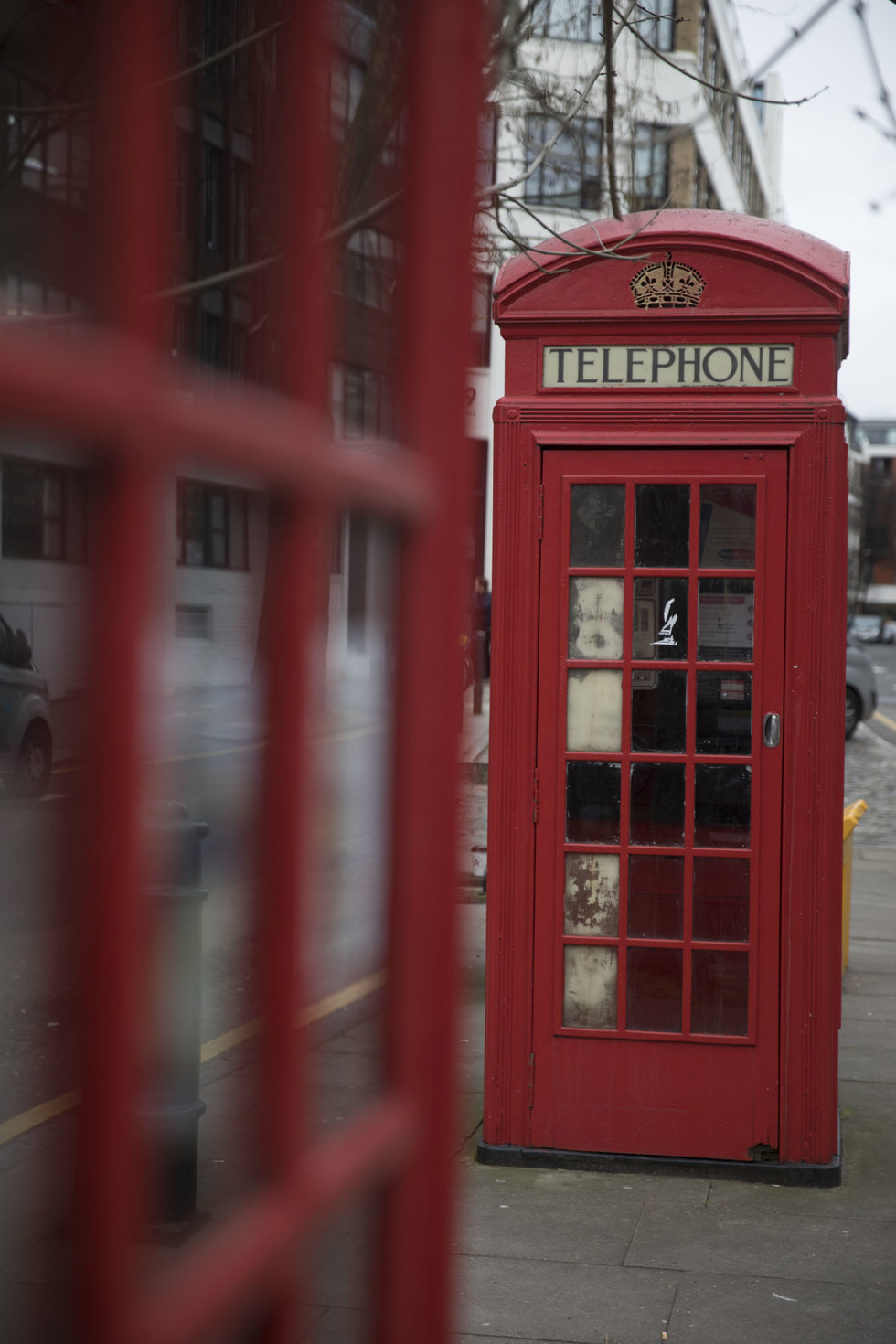 One of the city's enduring red phone booths