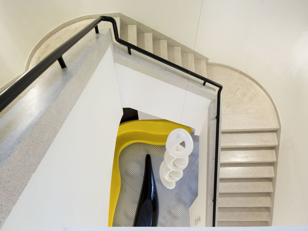 An eclectic staircase at The Poli House in Tel Aviv