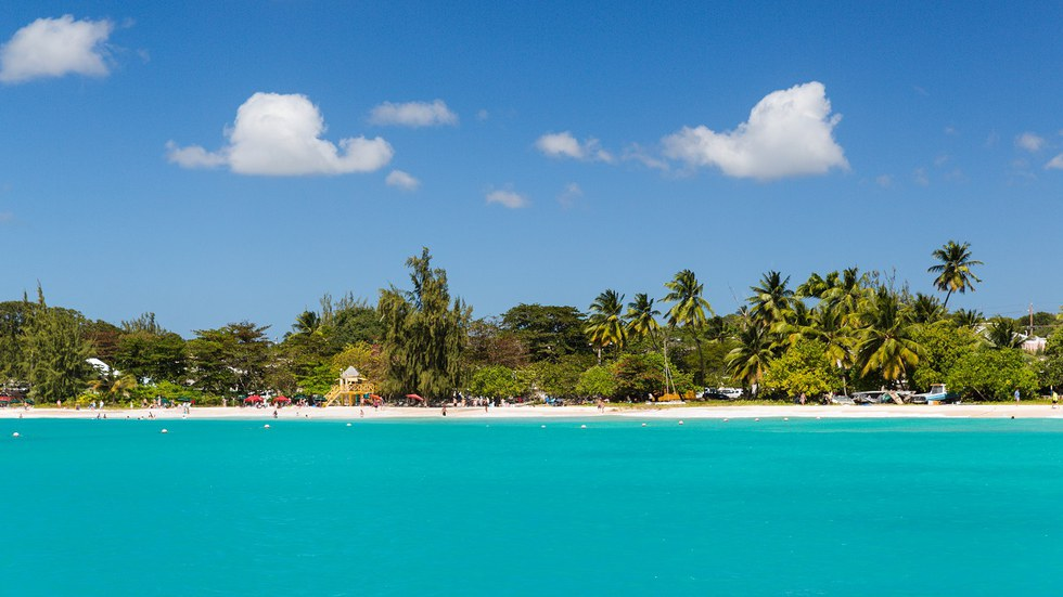 Shoreline filled with people in Barbados