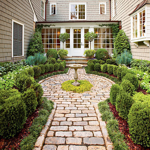 Turn a driveway into a cottage garden the snug for Southern living landscape design